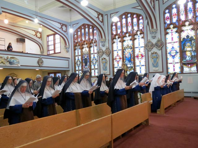 The Sisters chant the Te Deum at the close of their vows' ceremonies